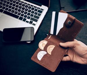 kaart portefeuille bruin hand munten